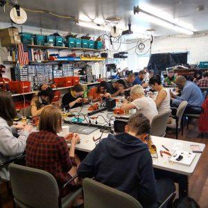Students taking electronics workshop